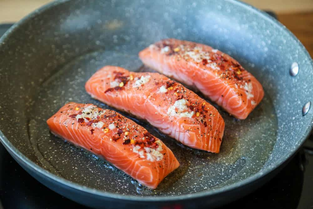 Easy pan fried honey garlic salmon - this meal is ready in just under 15 minutes!