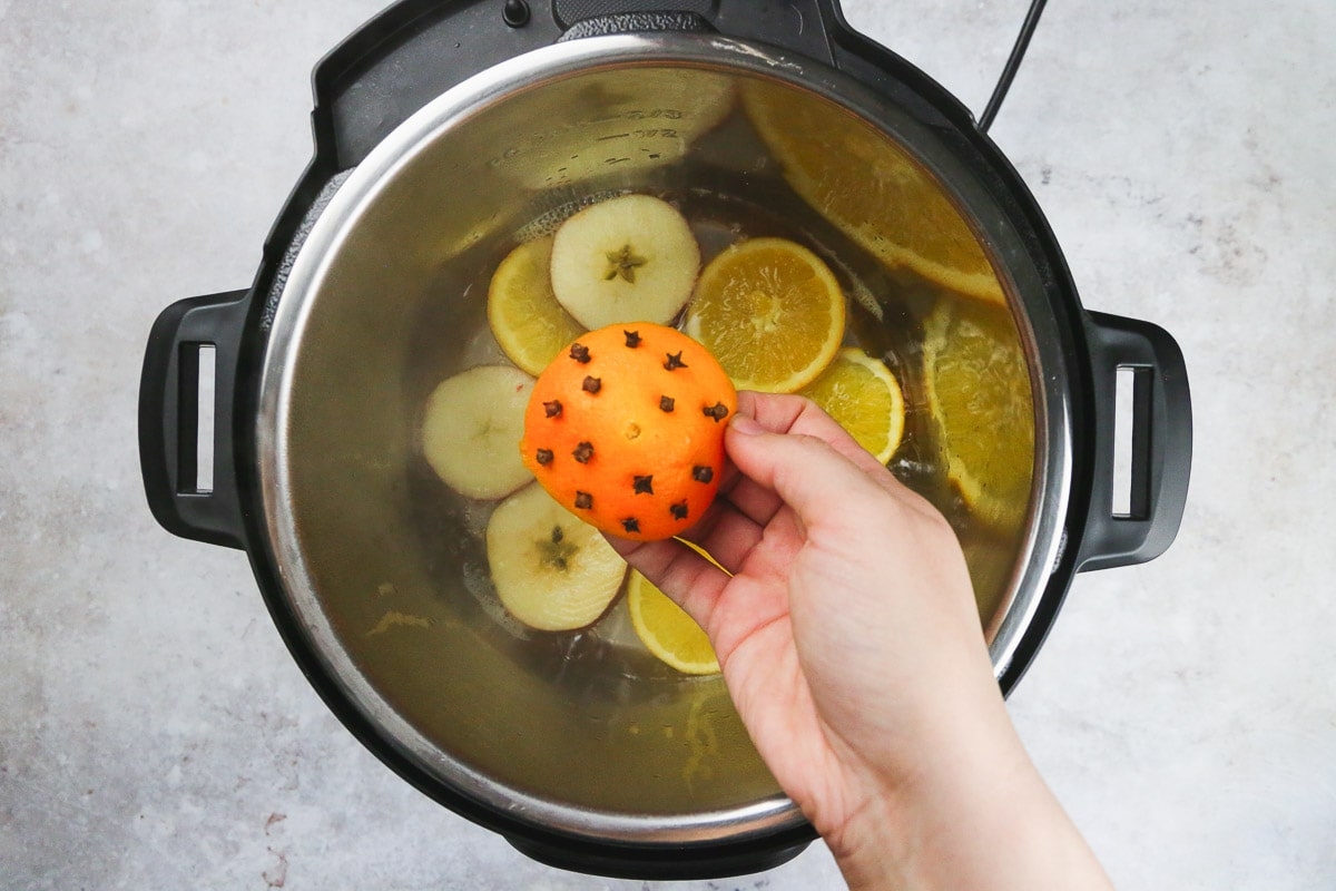 Adding orange peel with cloves to make mulled wine in the instant pot