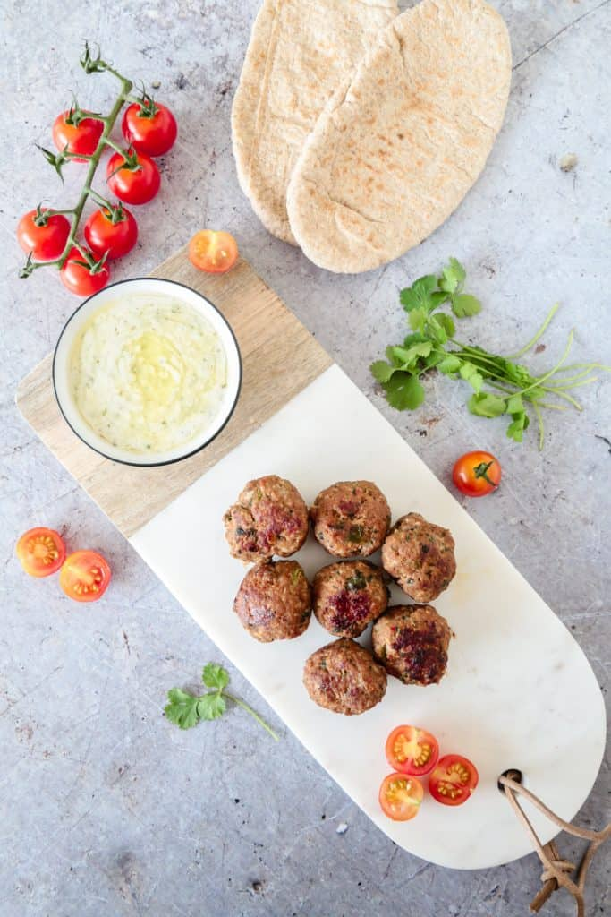 Simple Middle Eastern Kofta ball, fried in olive oil and served with flatbreads and garlic lemon sauce...