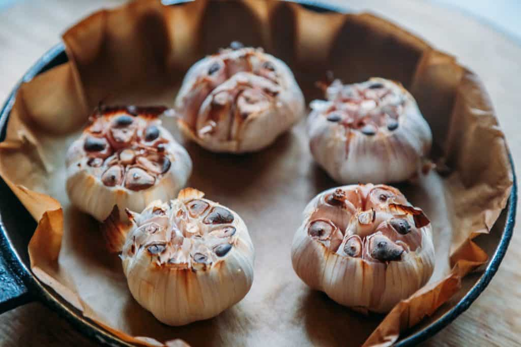roasting garlic cloves to make roasted garlic soup
