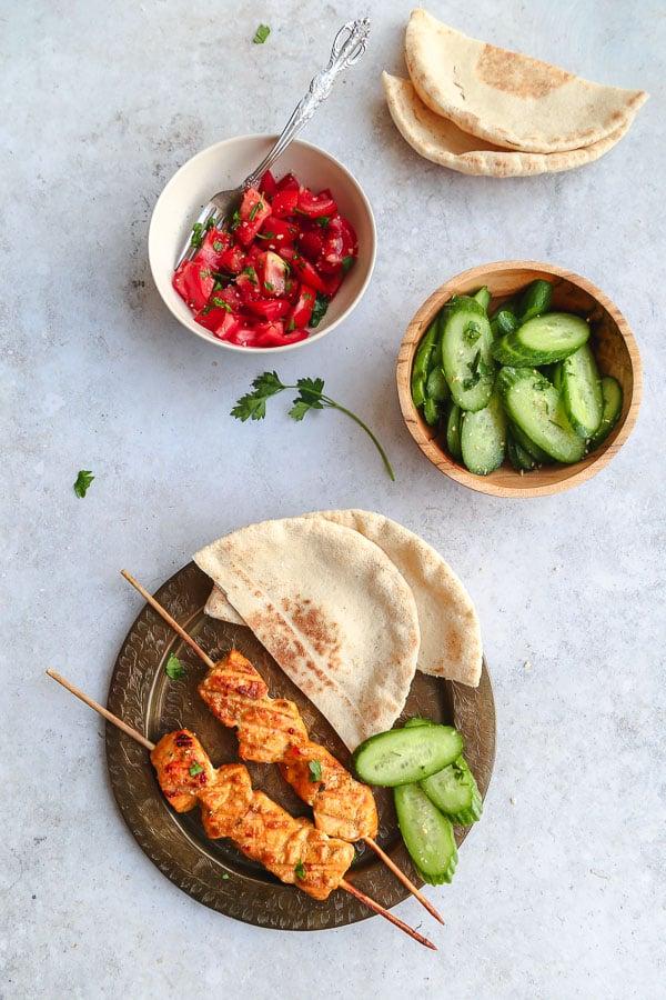 Tandoori salmon with cucumber raita and pita bread - recipe