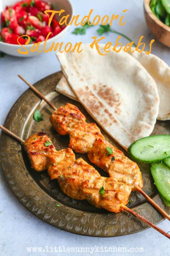 Tandoori salmon kebabs are perfect for a summer BBQ! Served in fresh pitas with a simple cucumber salad.