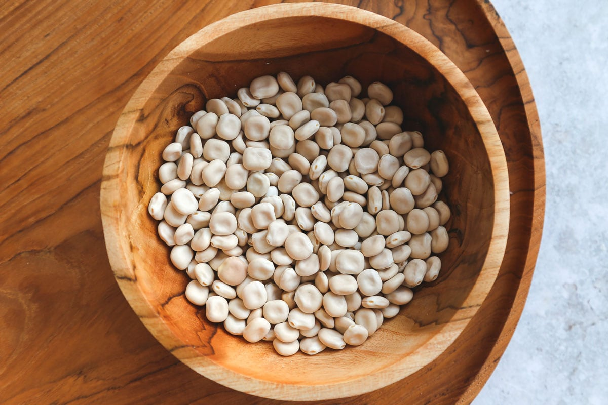 dried lupini beans in a wooden bowl