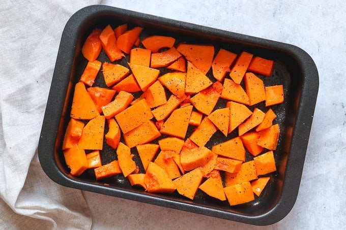 Roasting butternut squash in the oven, still raw
