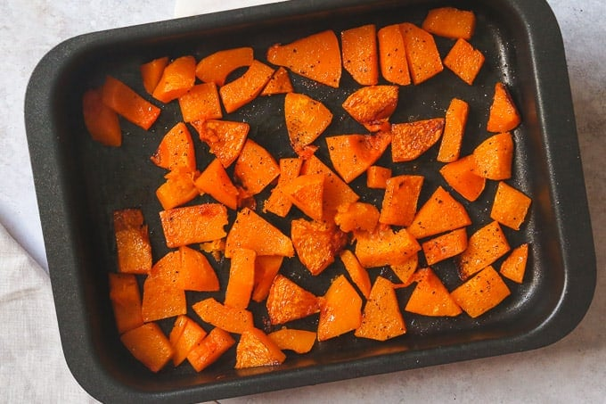 Roasted butternut squash in a baking tray