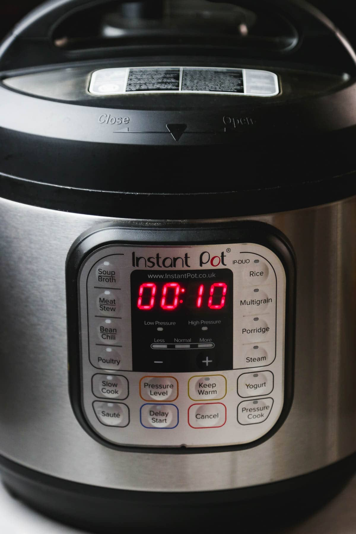 An Instant Pot showing the cooking time; 10 minutes on high pressure