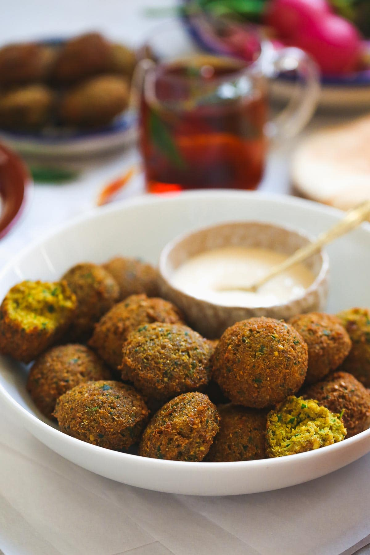 traditional falafel balls with a bite shot