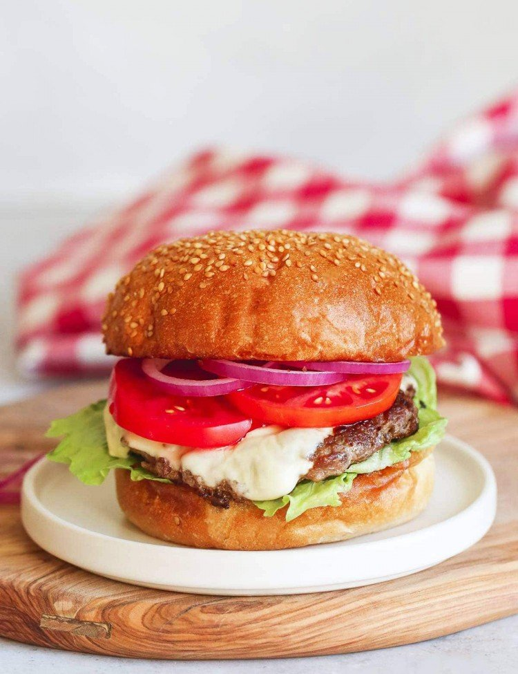 Instant Pot Burger served on a white plate placed over a wooden board