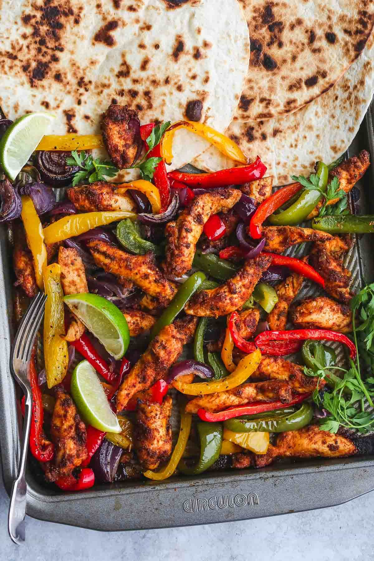 Baked Chicken Fajitas on a sheet pan with tortilla bread