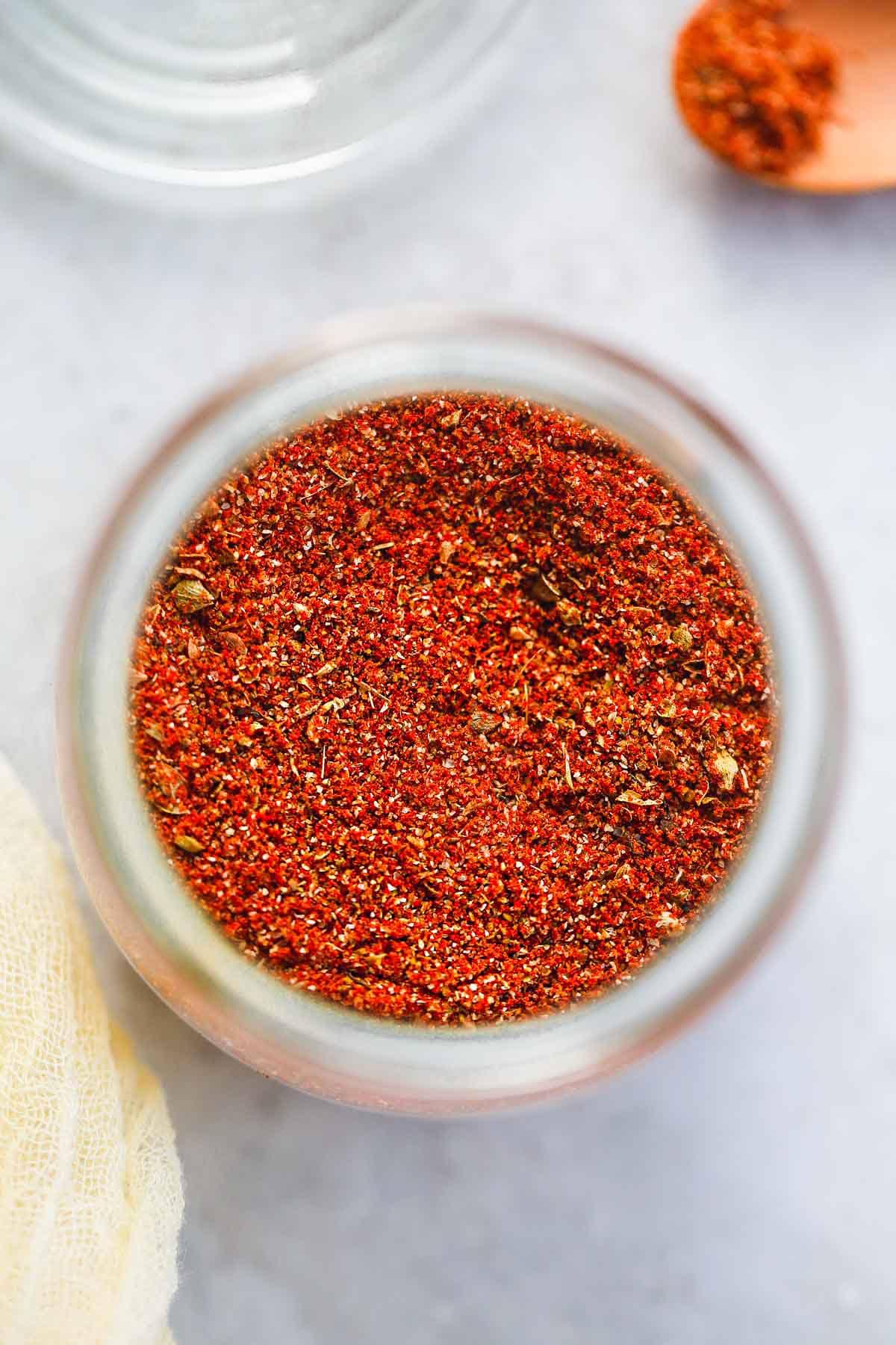 A close up shot of fajita seasoning in a Weck jar, top view.