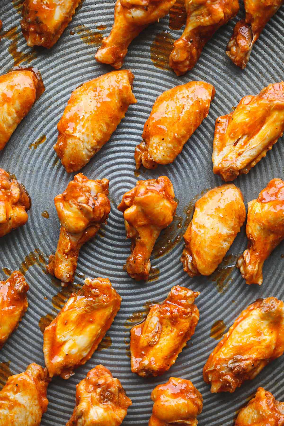 Chicken wings on a sheet pan before broiling