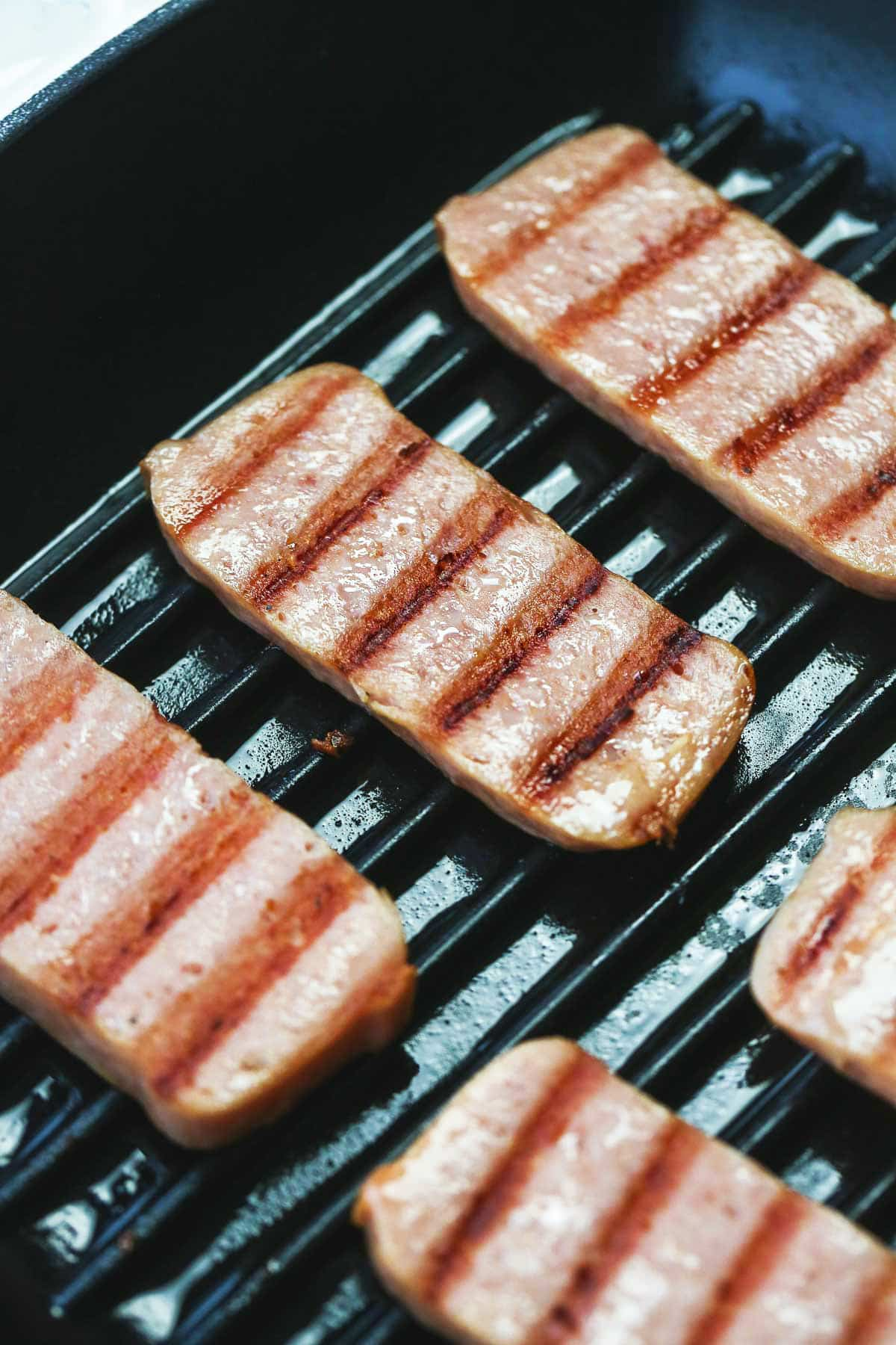grilled SPAM® Steaks with grill marks on them