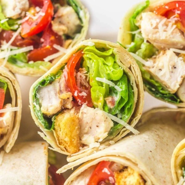 Caesar chicken wraps stacked on each other