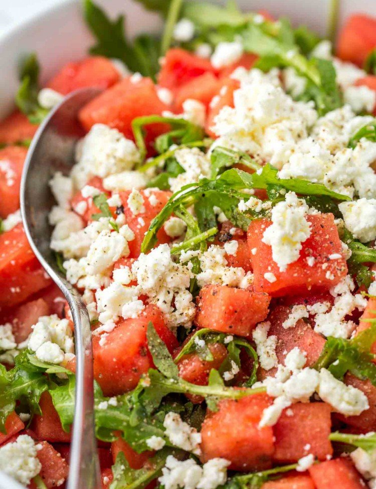Watermelon and Feta Salad in a large serving bowl with a serving spoon