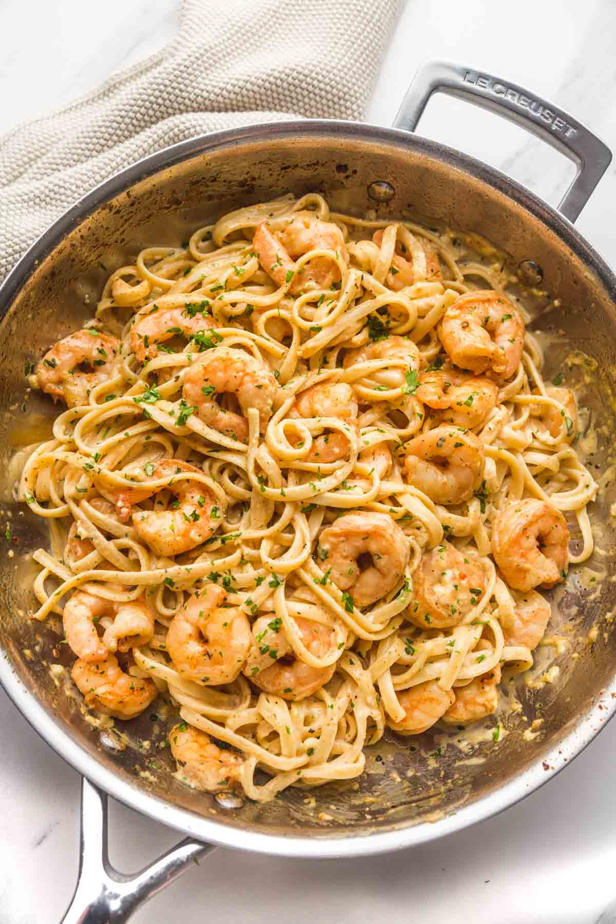 Garlic Butter Shrimp Pasta in a stainless steel Le Creuset pan