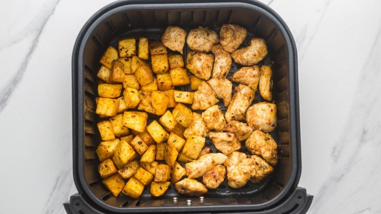 Air Fryer Chicken and Potatoes cooked in the air fryer