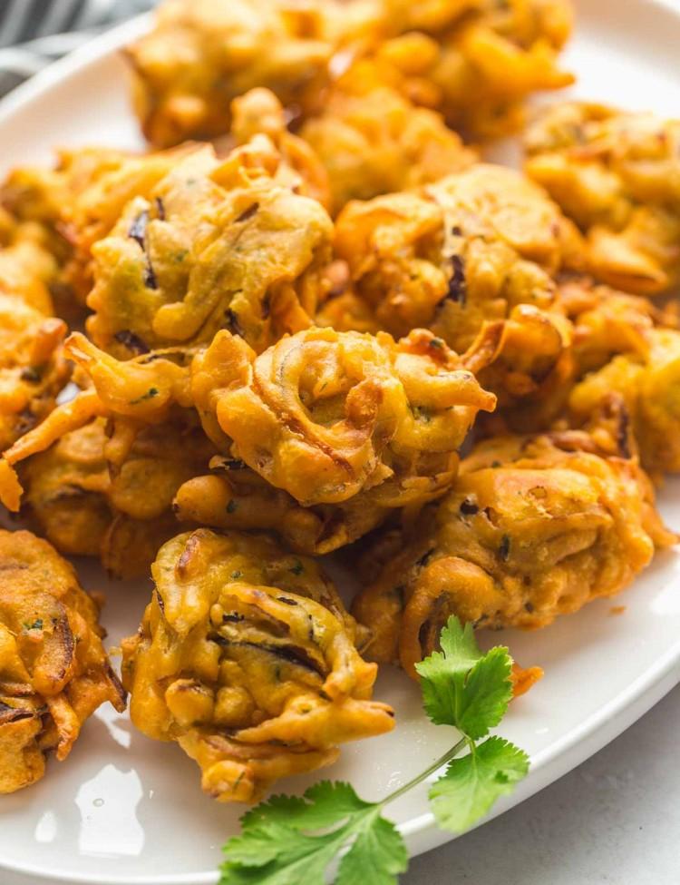 Fried onion bhaji served on a white plate