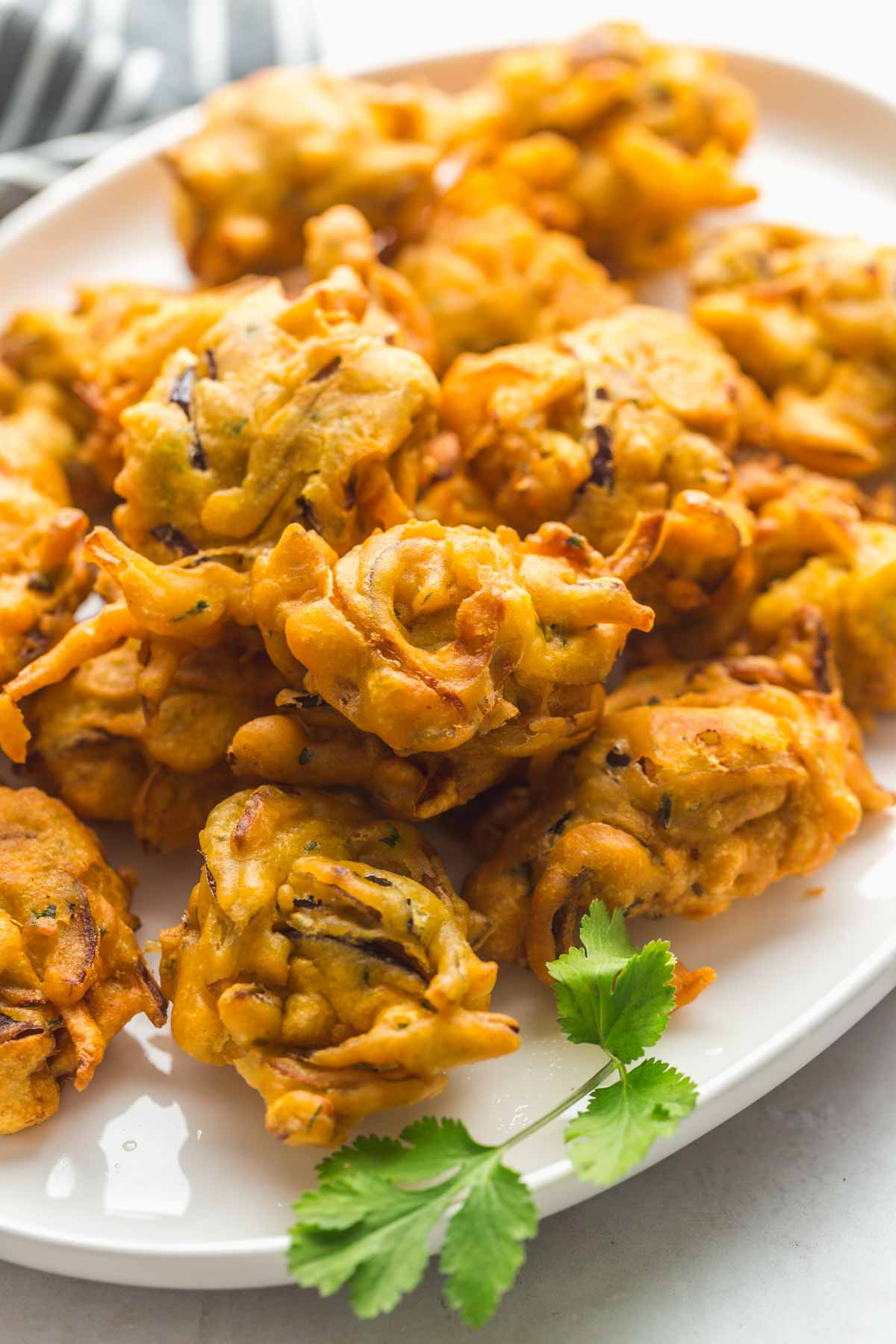 Fried onion bhaji served on a white platter