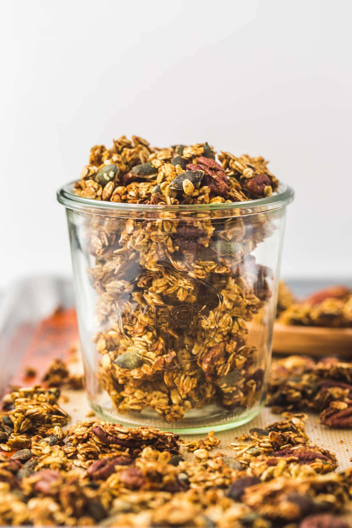 A large Weck jar filled with crunchy granola