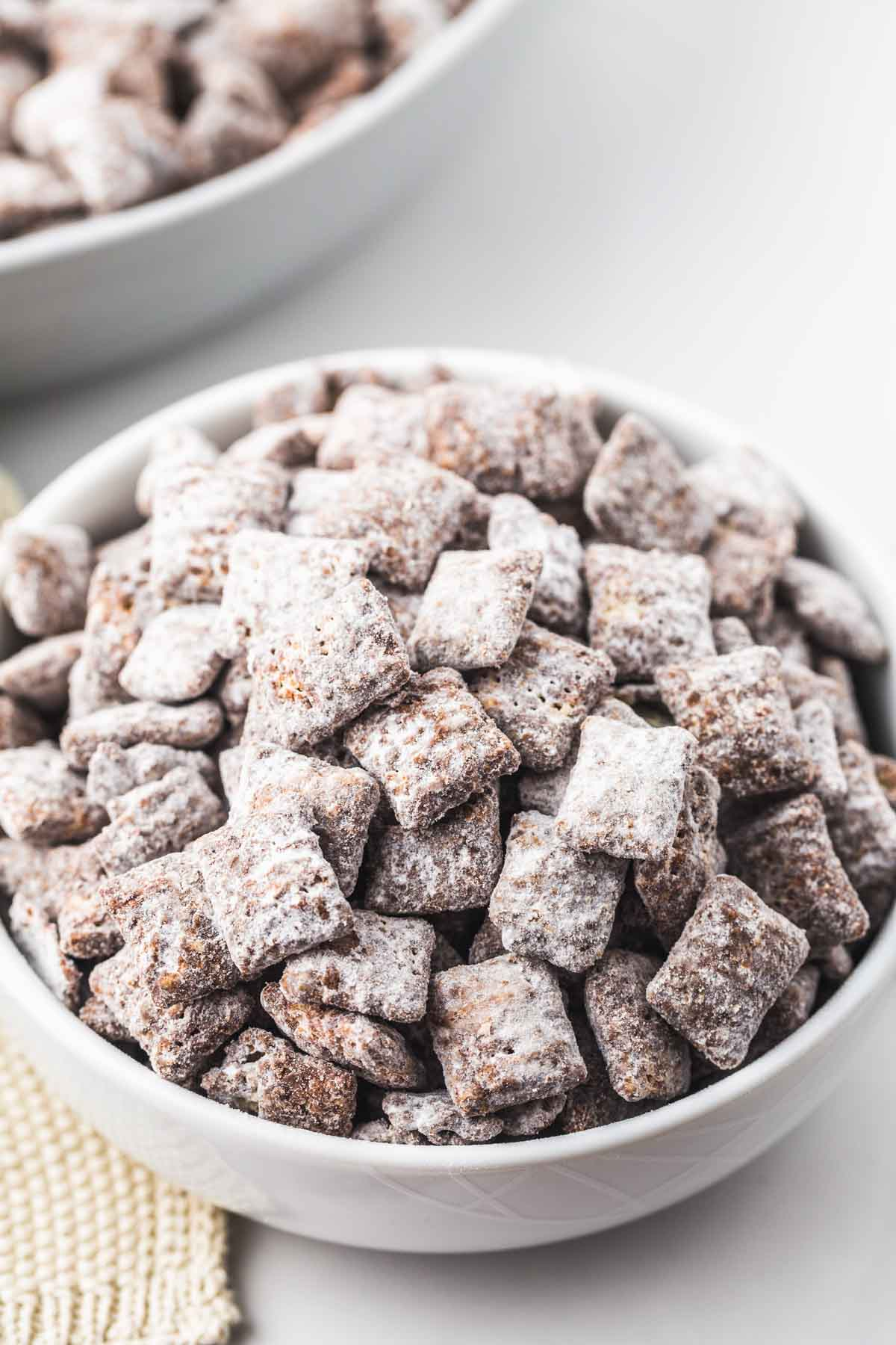 Puppy chow served in a small white bowl