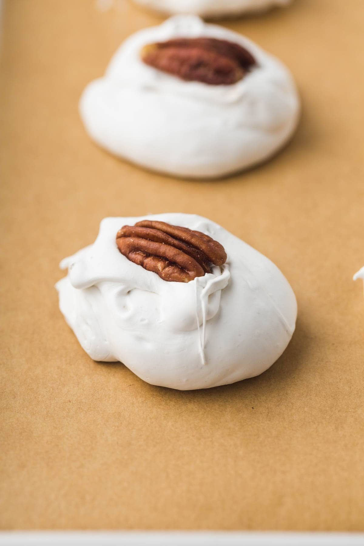 Close up of pecan divinity candy on parchment paper