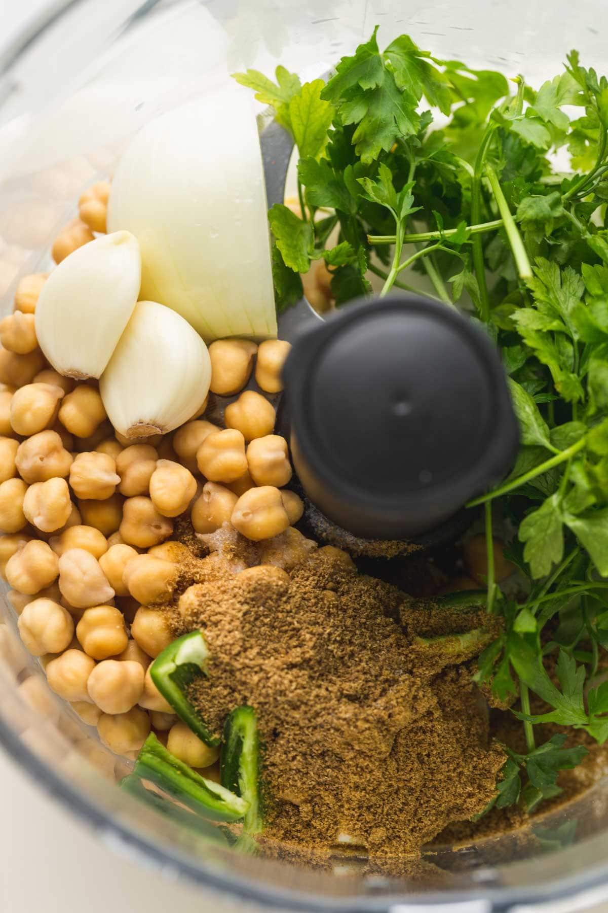 Falafel ingredients in a food processor