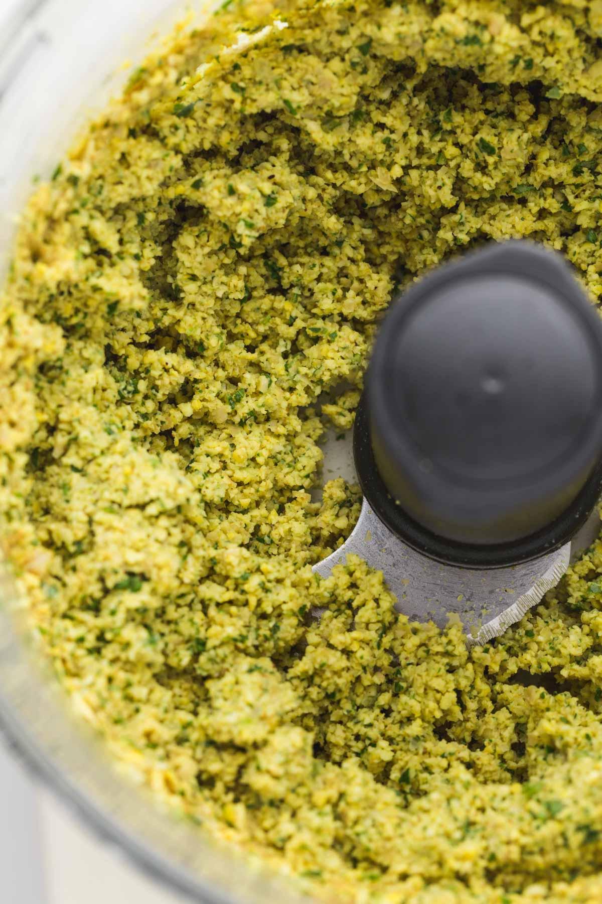 Falafel mixture in a food processor - close up