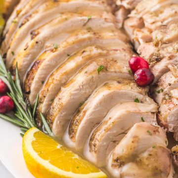 Sliced turkey breast on a platter with gravy