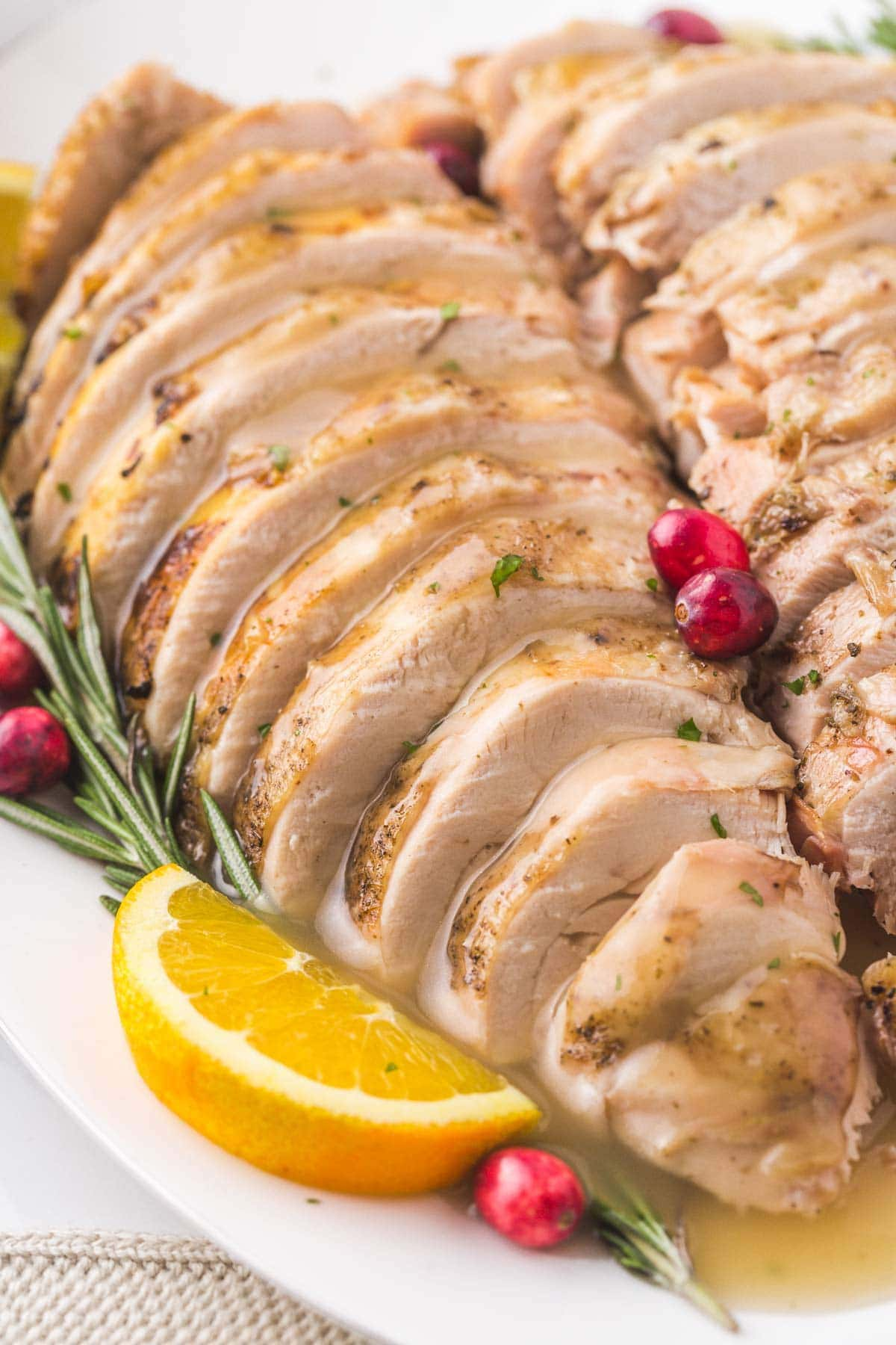 Close up of a sliced turkey breast with gravy