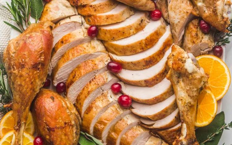 Carved and sliced turkey served on a large platter
