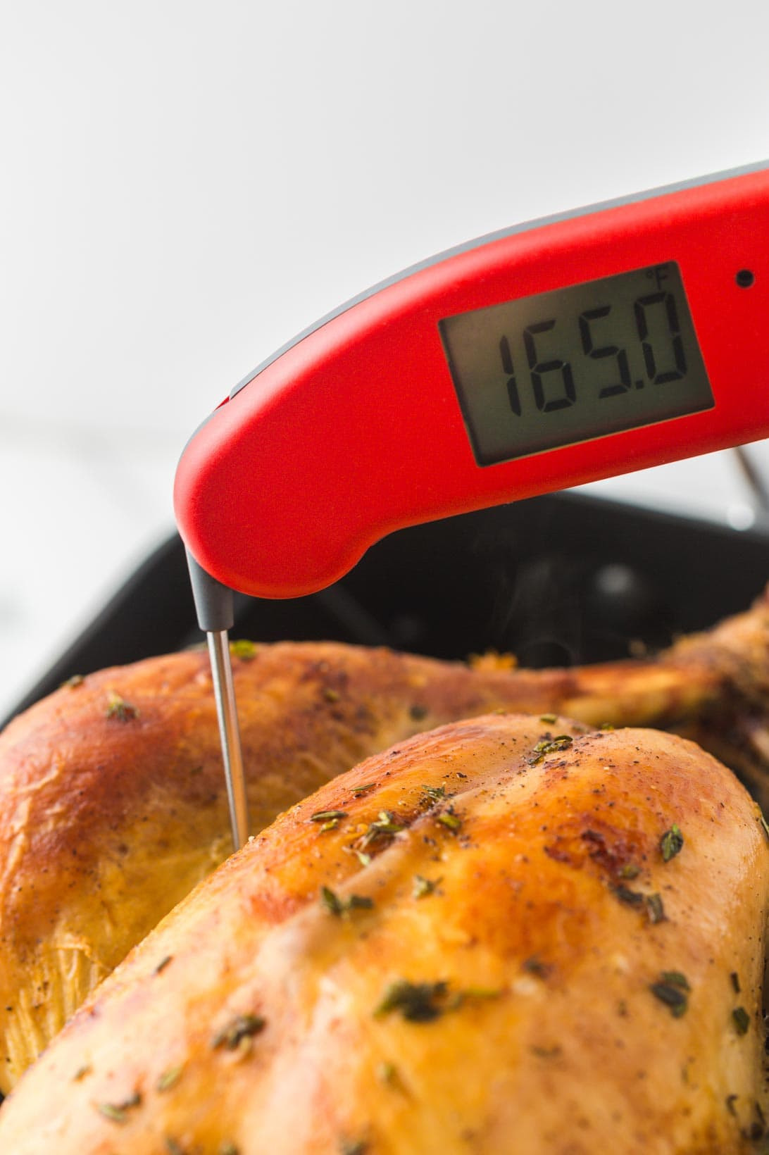 Checking the turkey temperature with Thermapen, registering 165°F