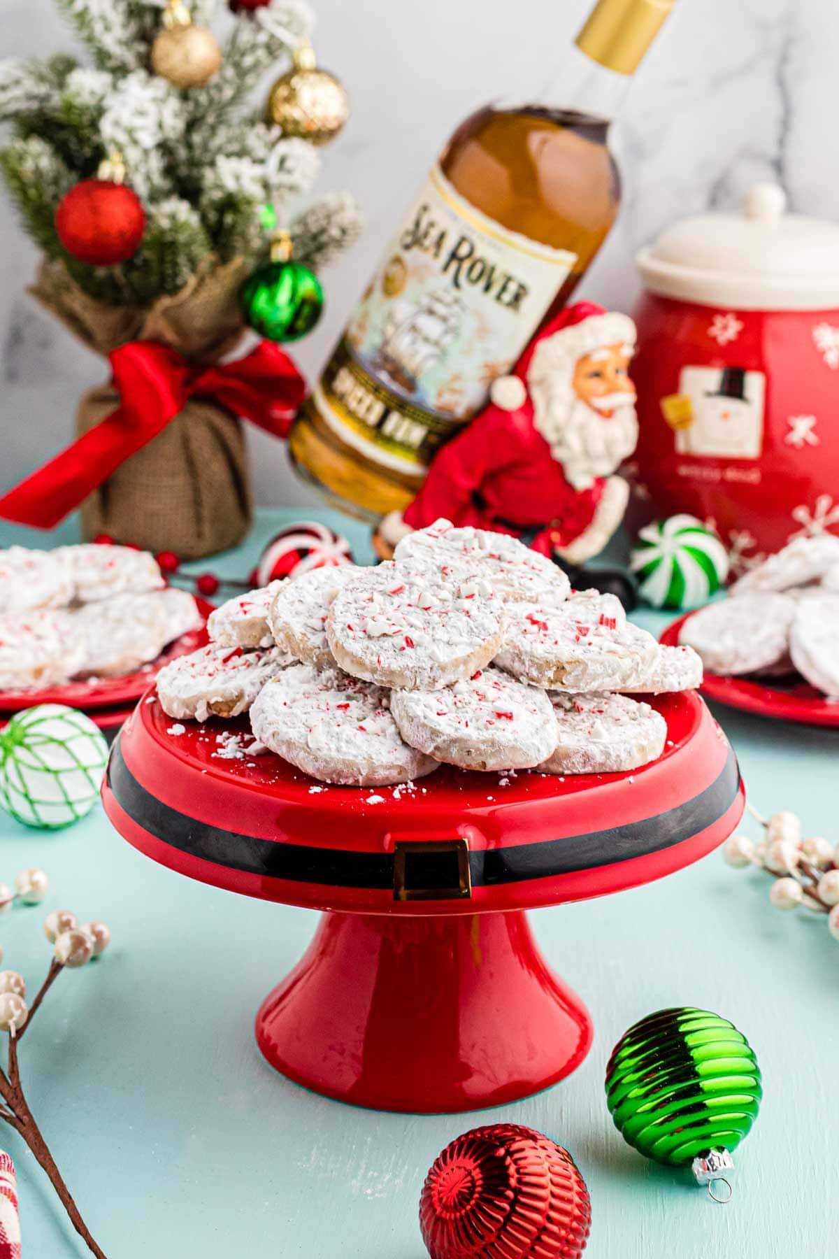 Slice and bake cookies served on a festive cake stand, with Christmas decorations