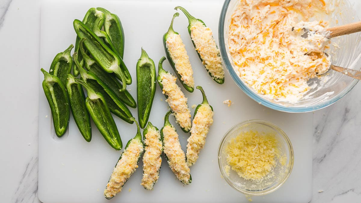 Filling jalapenos with cream cheese filling, and topping the panko