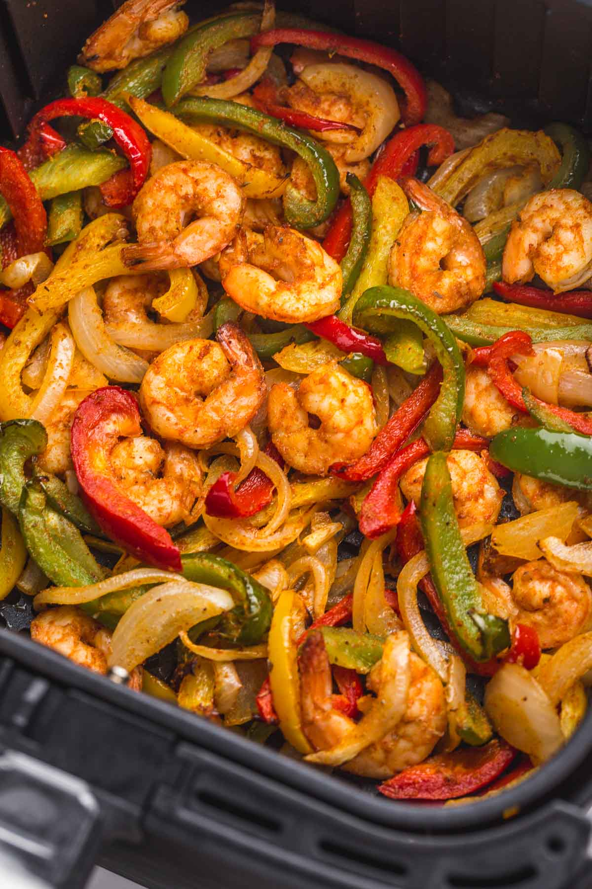 Shrimp fajitas in the Air Fryer basket.
