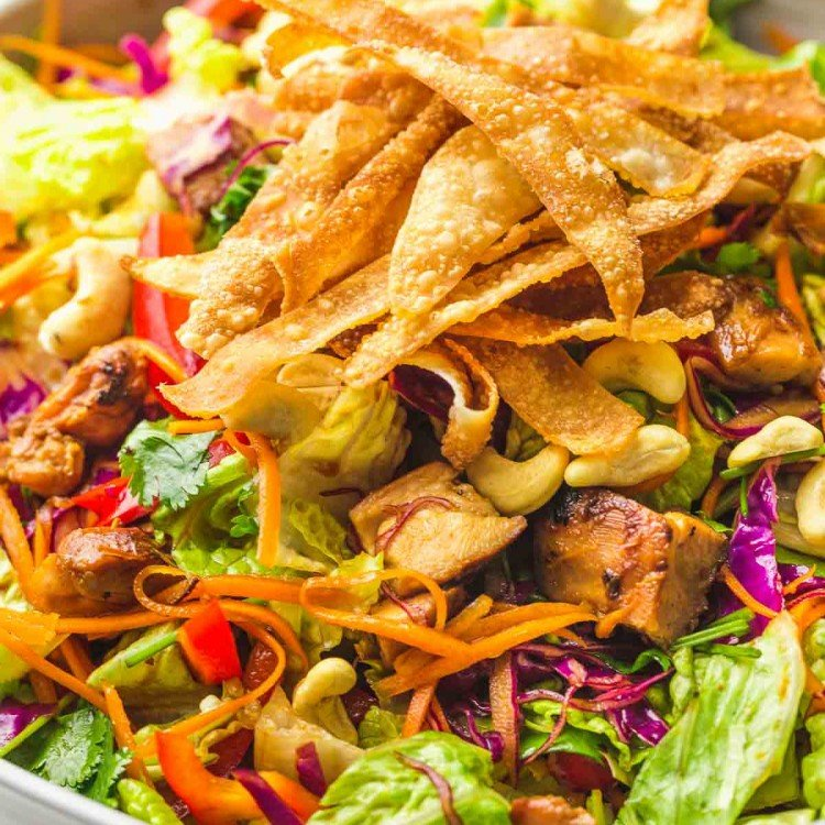 Asian chicken salad with wonton chips, in a large serving bowl