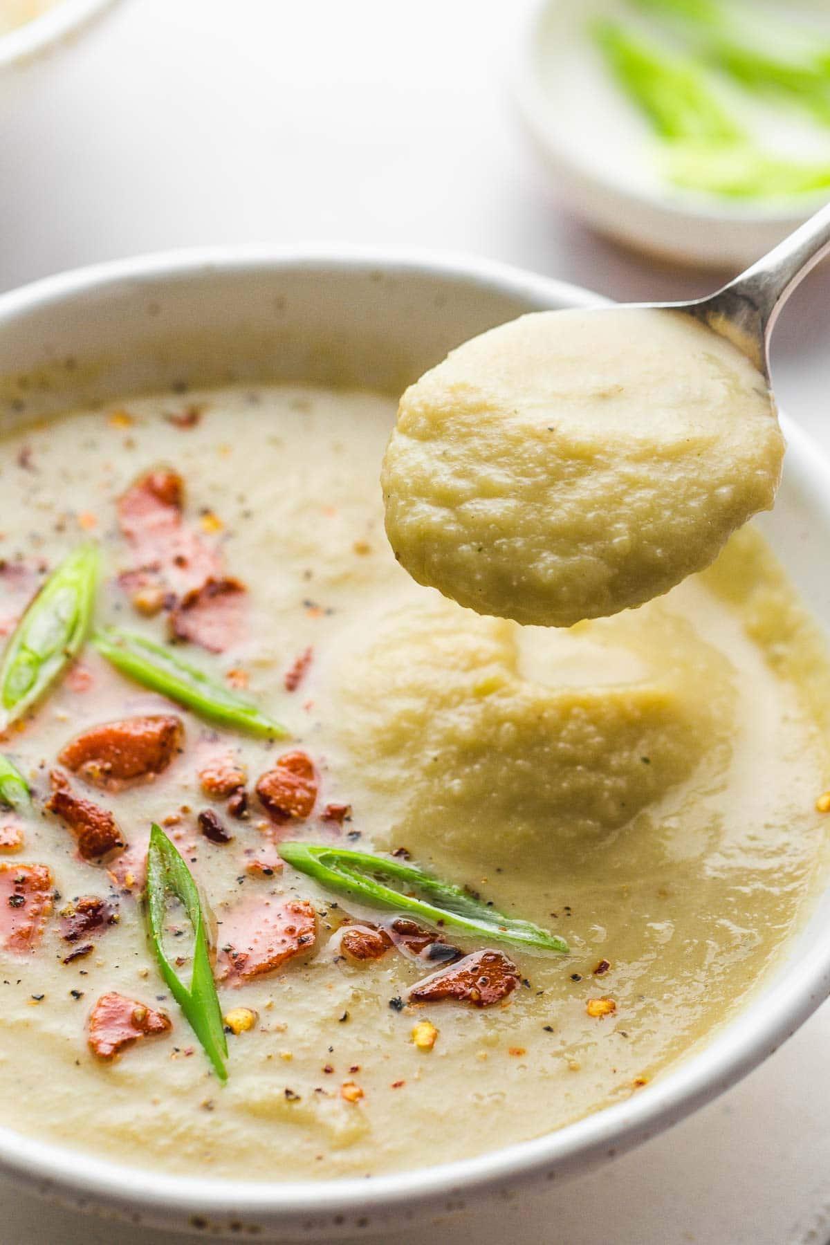 Close up of a spoonful of cauliflower leek soup