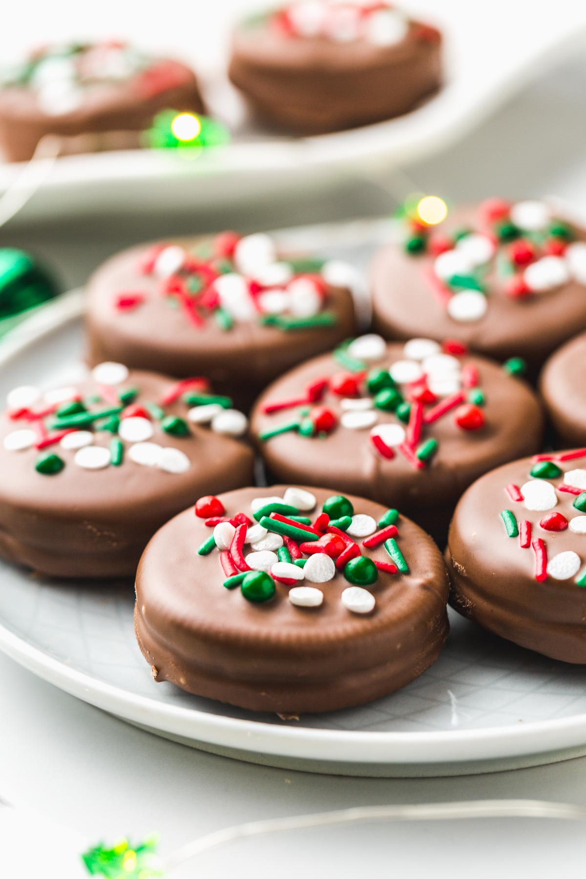 7 Chocolate Covered Oreos on a plate, side view.