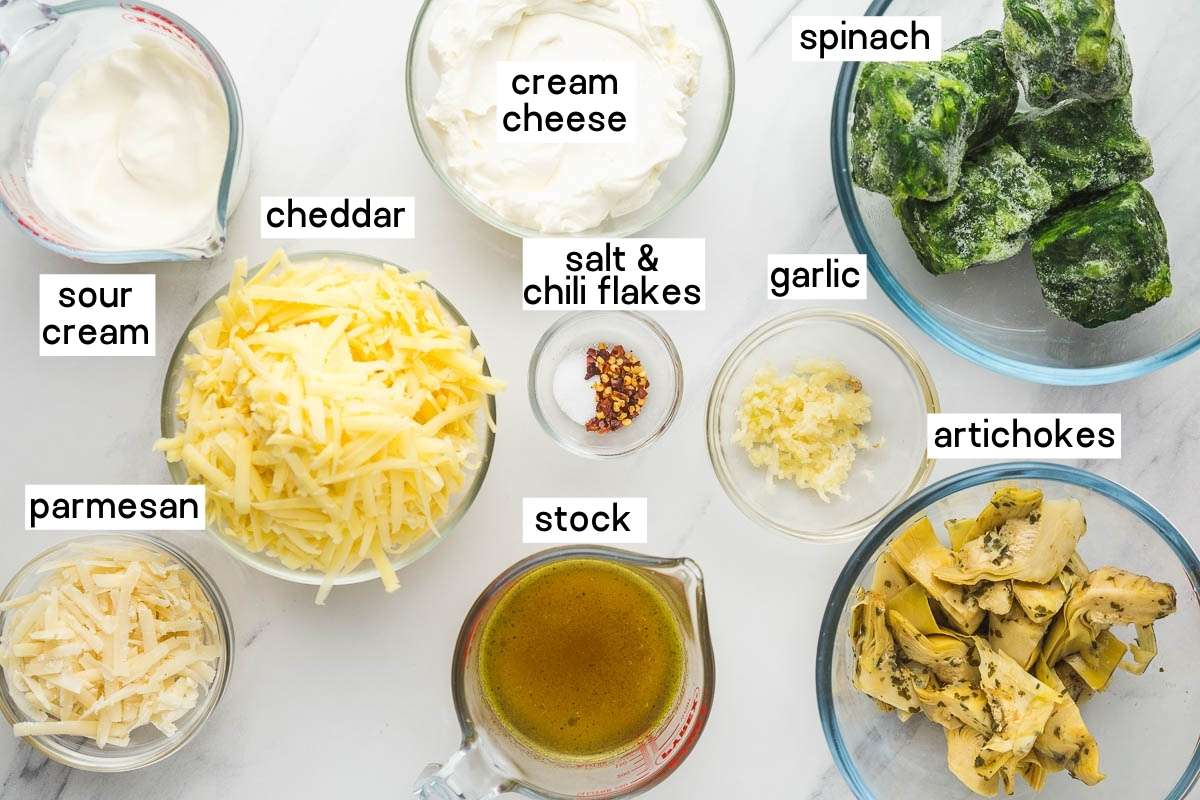 Ingredients needed to make spinach artichoke dip