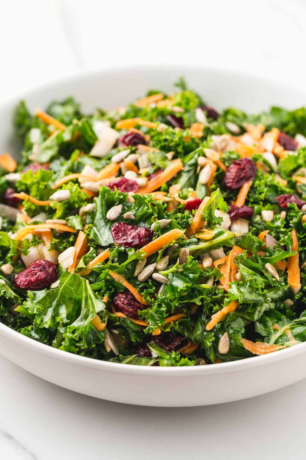 Kale salad in a large white bowl