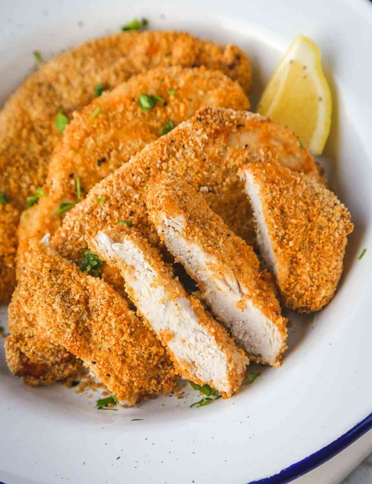 crispy air fryer chicken breasts, sliced and plated