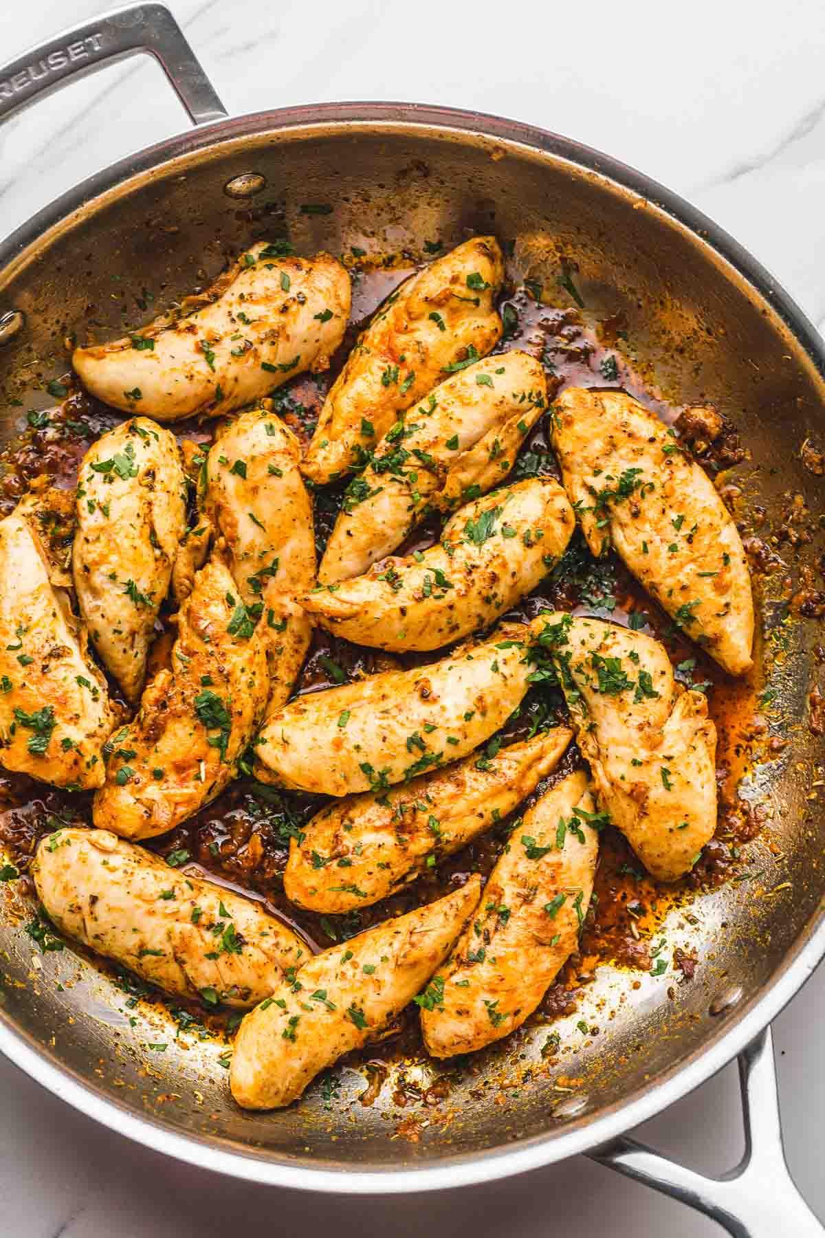 Chicken tenders in a le creuset skillet