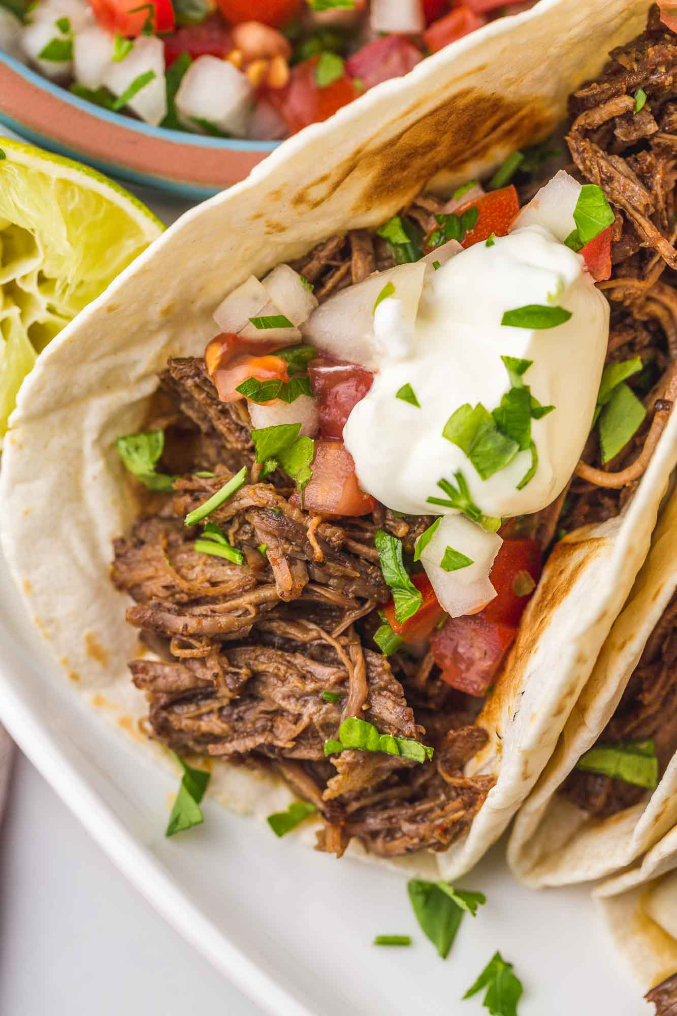 Close up shot of shredded beef taco
