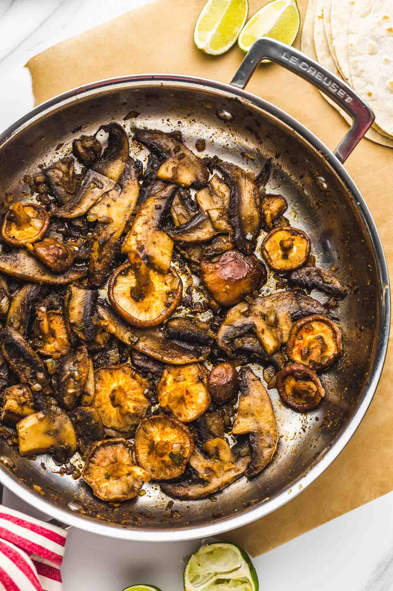 Sauteed mushrooms with taco seasoning in a stainless steel pan