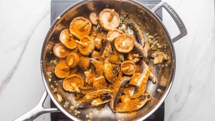 Mushrooms with taco seasoning in a skillet