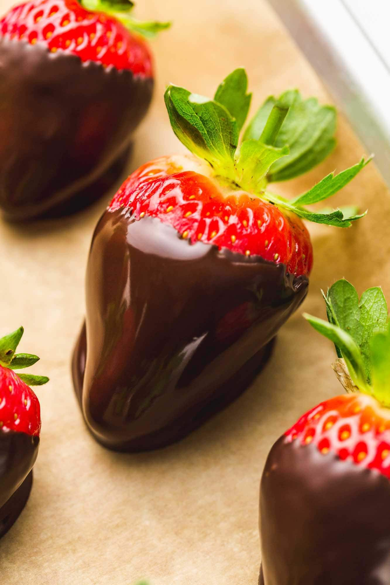Strawberry dipped in chocolate then placed on parchment lined cookie sheet