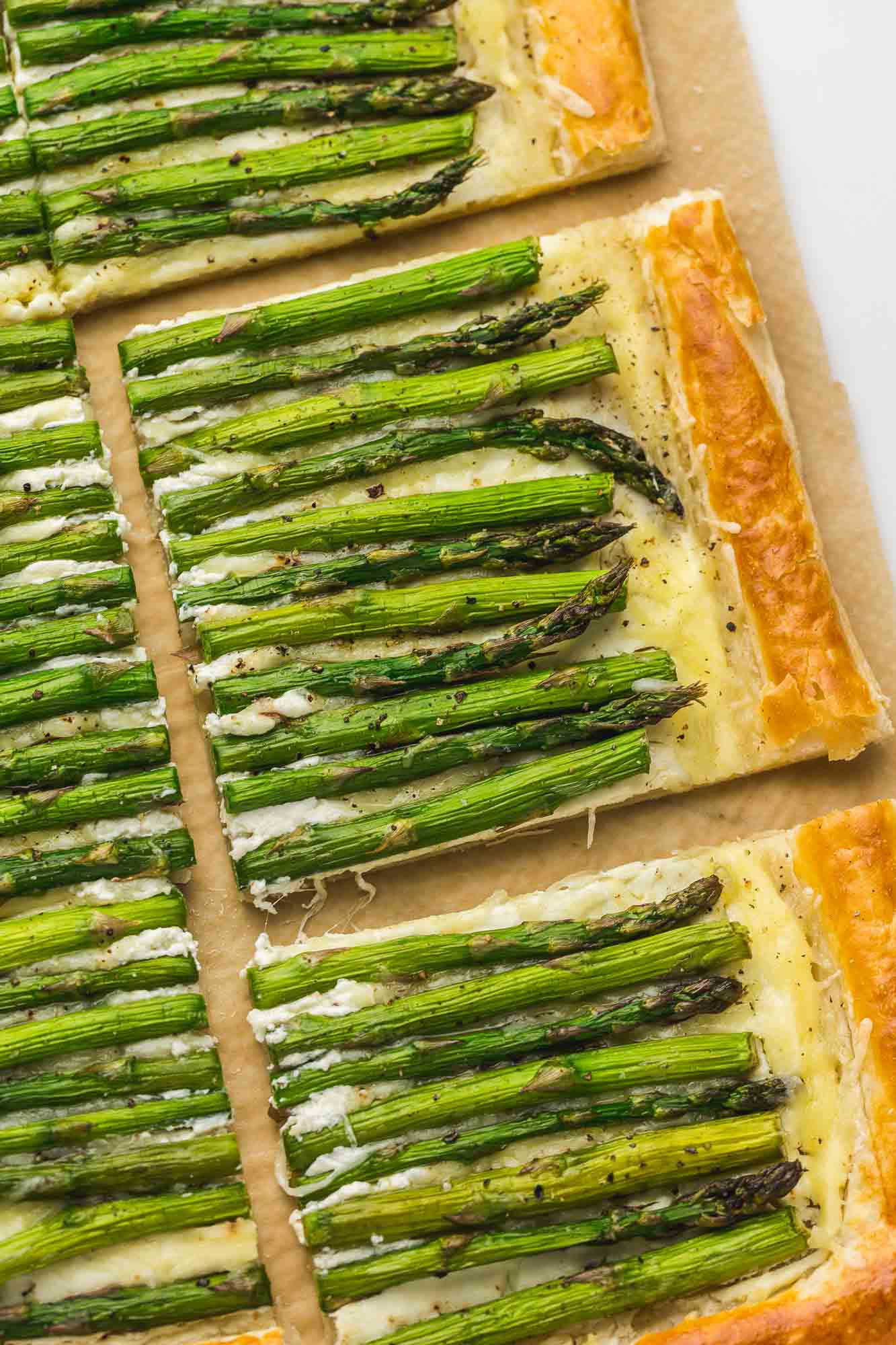 Squares of cheesy asparagus tart and crispy puff flaky puff pastry