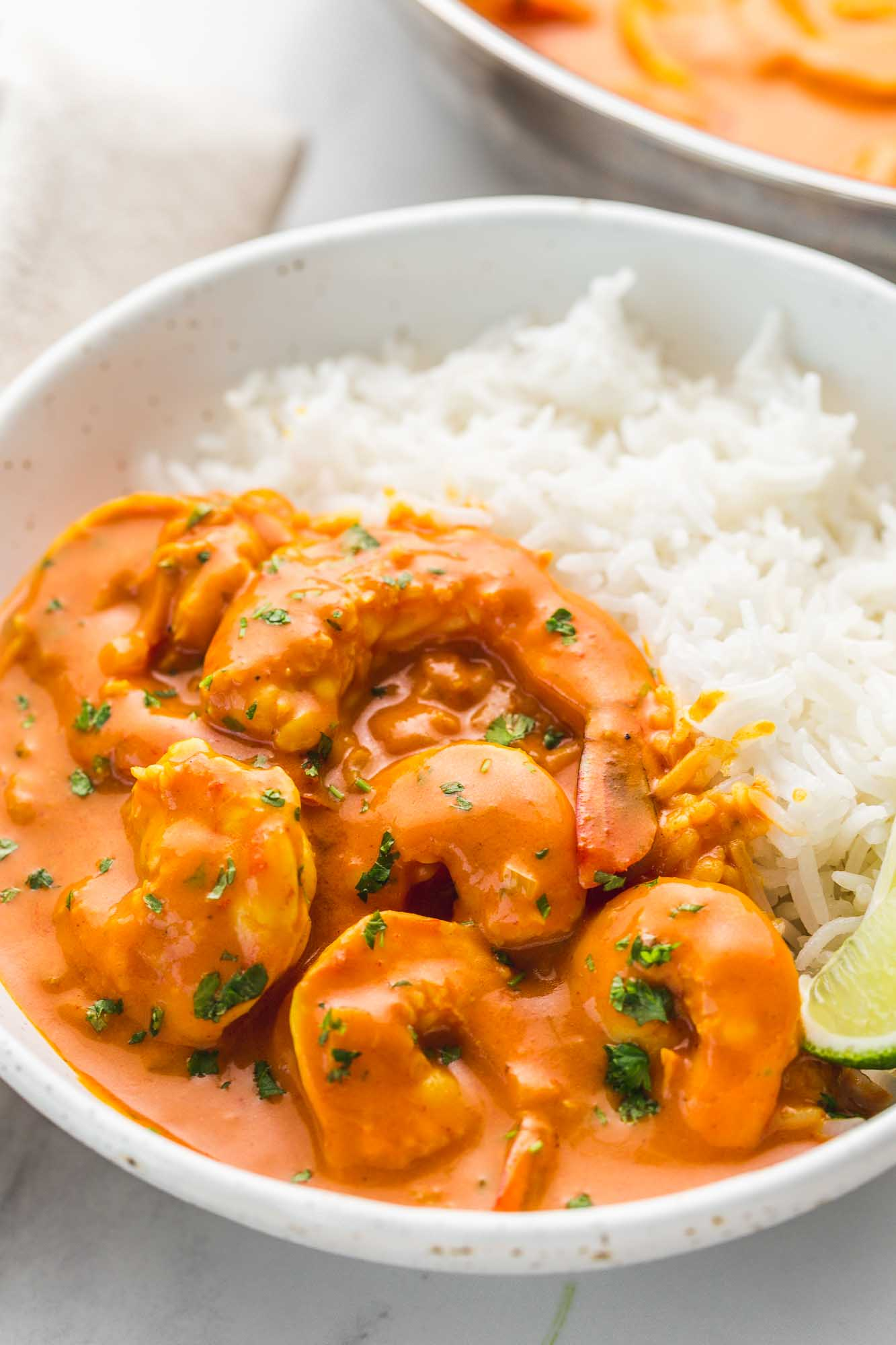 Coconut shrimp curry served in a white bowl with white rice