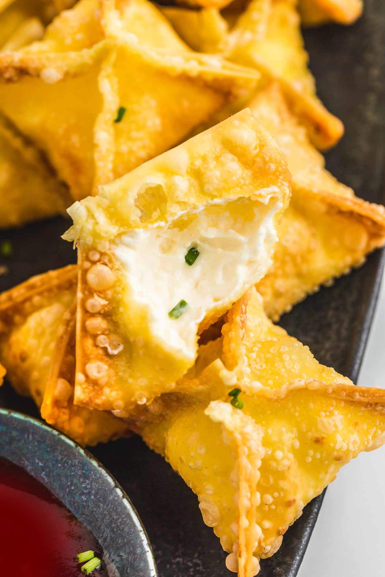 Cream cheese rangoons from the inside filled with soft cream cheese and chives