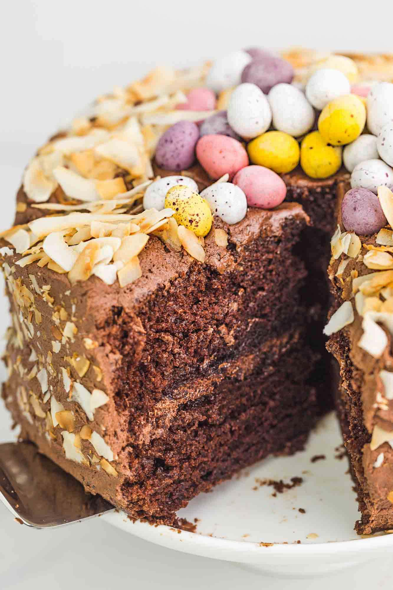 Slicing the chocolate easter cake