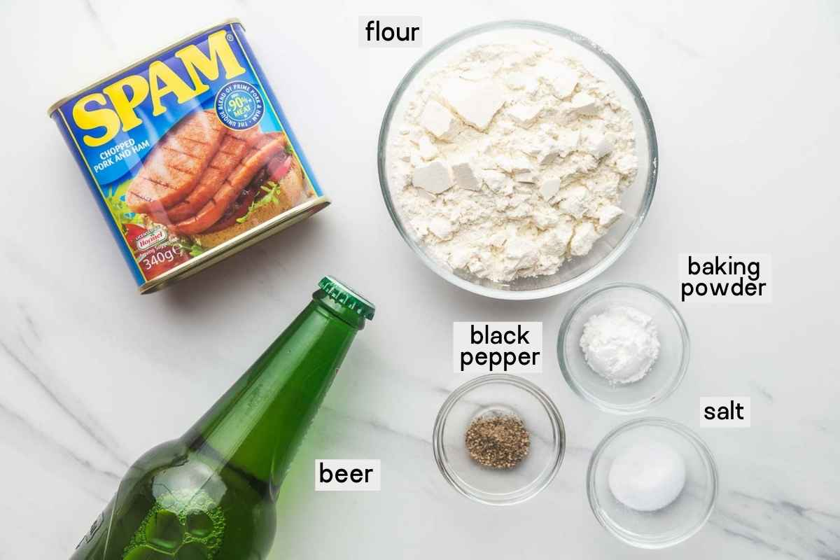 Ingredients needed for SPAM fritters, SPAM, beer, flour, baking powder, salt and pepper.